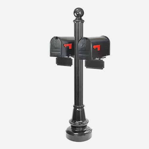 Dual steel mailbox unit on round pole with round ball finial and address plaques. Brandon Industries model DBC46-AM94-9X.