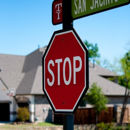 MUTCD compliant stop sign in front of house